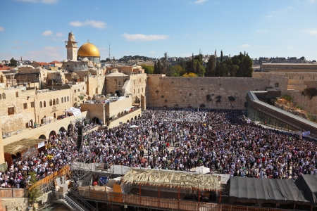 The most joyous holiday of the Jewish people - Sukkot  The Western Wall in Jerusalem temple  The area in front of it filled with people from morning prayers