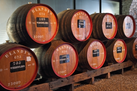 MADEIRA  ISLAND, PORTUGAL - OCTOBER 8: Classic huge oak barrels of wine  Madera. Storage of wine well-known firm BLANDYS