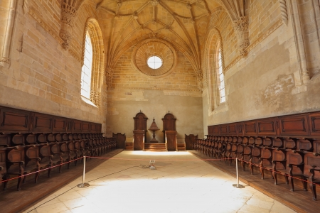 The imposing medieval castle of the Knights Templar in Portugal. The magnificent chapel with a vaulted ceiling and rows of oak chairs