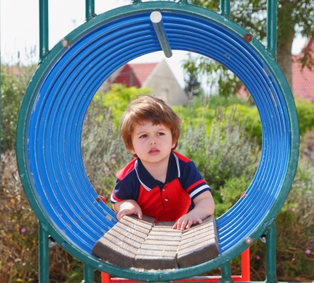 TLittle boy playing on the playground   photo