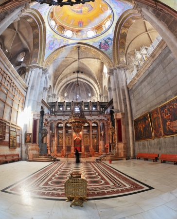sepulcher:  Huge beautifully decorated hall in front of the Edicule. Hall is  lit sunlight through windows in the domed ceiling and lamps. Church of the Holy Sepulcher in Jerusalem. Editorial