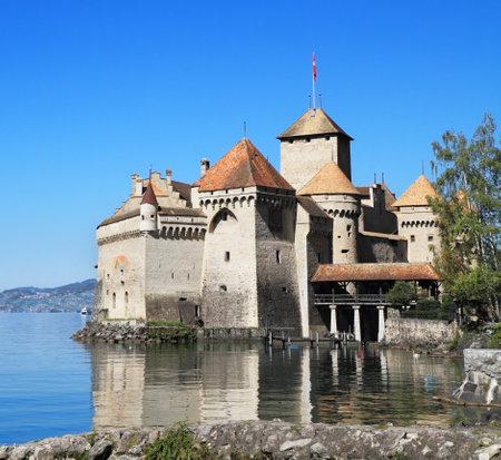 chillon: The world-famous Castle of Chillon on Lake Geneva  A beautiful sunny day in Switzerland Editorial