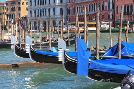 approached: Wonderful holiday in Venice  Graceful gondola approached by a magnificent old palaces