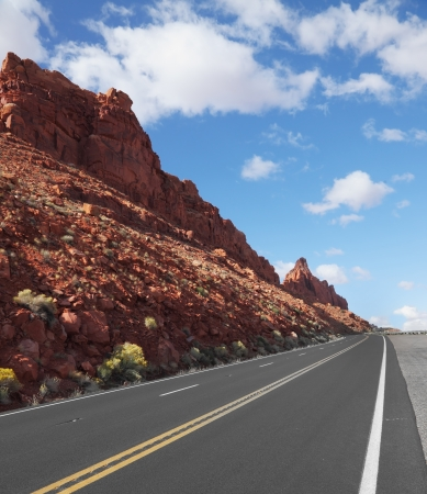 The magnificent marked American road passes between rocks of red sandstone photo