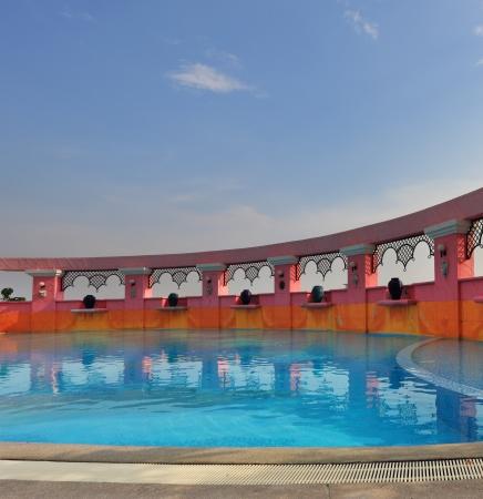 twentieth: Elegant pool on the twentieth floor of magnificent hotel of Bangkok. A sunset