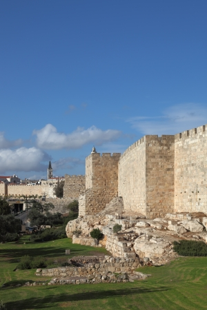 A lovely sunny day in Jerusalem. The walls and towers against the sky and clouds Stock Photo - 17586185