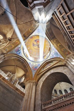 sepulchre: On the ceiling in the Hall of the Holy Sepulchre image of Christ the Savior. Gorgeous round arch ceiling lit by two bright rays of the sun