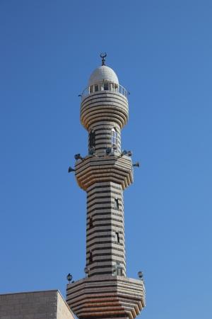 circassian: Slender ornate minaret  Ancient Circassian village of Kafr Kama in Israel Stock Photo