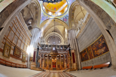 sepulcher: Church of the Holy Sepulcher in Jerusalem. Huge beautifully decorated hall in front of the Edicule. Hall is beautifully lit sunlight through windows in the domed ceiling and lamps. The picture was taken Fisheye lens