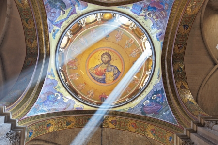 sepulchre:  Facilities in the Holy Sepulchre.  The magnificent round arch of a ceiling is shined with two bright beams of the sun. On a ceiling image of the Christ Savior Editorial