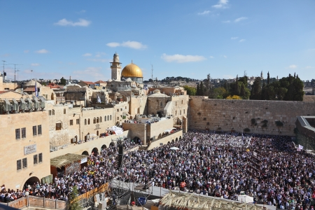 The Western Wall in Jerusalem temple. The area in front of it filled with people from morning prayers. The most joyous holiday of the Jewish people - Sukkot.