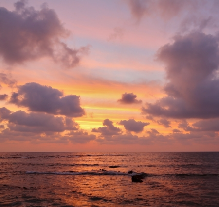 enchanting: Enchanting sunset on Mediterranean sea. Pink clouds and reflections on the water