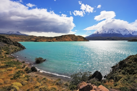 torres del paine: Magic turquoise lake Pehoe national park Torres del Paine, Chile. Majestic rocks Los Kuernos on the bank of the lake are covered with glaciers