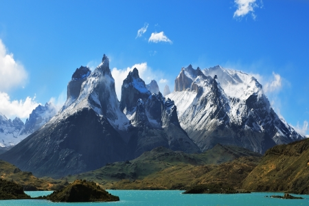 torres del paine: Epic beauty of the landscape - the National Park Torres del Paine in southern Chile  Cliffs of Los Kuernos in cold windy summer day