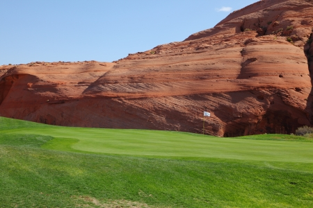 level playing field: Hills from red sandstone and green grassy hills for a golf