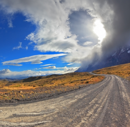 National Park Torres del Paine in Chile. Awesome cloud over a gravel road. The picture was taken Fisheye lens photo