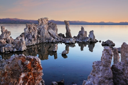 calcareous: The magic of Mono Lake. Outliers - bizarre limestone calcareous tufa formation on the smooth water of the lake