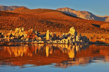 calcareous: Blazing orange sunset at Mono Lake.  Yosemite National Park, USA. Outliers -  bizarre calcareous tufa formation  reflected in the mirrored surface of the water
