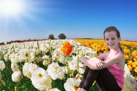 kibbutz: Charming smiling girl with a scythe in the kibbutz field of blooming yellow and red buttercups