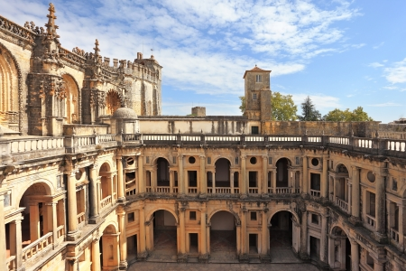 knights templar:  Courtyard, patio, surrounded by a gallery. The imposing medieval castle of the Knights Templar and the bell tower