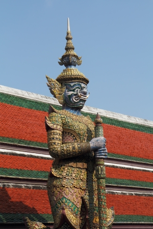 Log huge statues  the genie and the demon. Red-green tile roofs and galleries photo