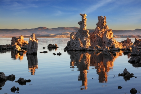 calcareous:  Outliers -  bizarre calcareous tufa formation  reflected in the mirrored surface of the water. The picturesque sunset at Mono Lake. Yosemite National Park, USA