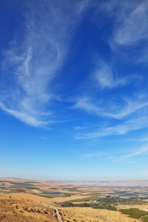 israel agriculture: Blue sky over the Isreel Valley blooming. Fields, meadows and villages were photographed from Mount Barkan. Sunset