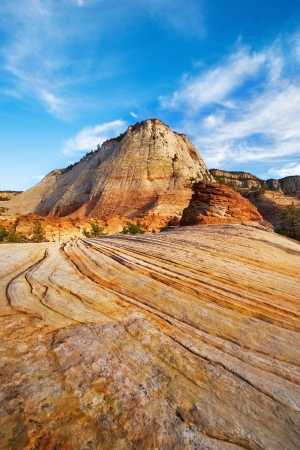 Red and orange hill on a uneven striped soil