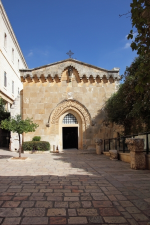 The great city of Jerusalem  Entrance to the church in the Christian quarter of Old City photo