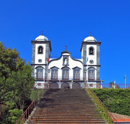 conducts: To the magnificent white church  the long picturesque ladder conducts  Sights of the Portuguese island of Madeira