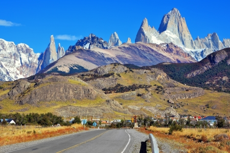 fitz roy: Famous rock Fitz Roy peaks in the Andes. Magnificent panorama of snow-capped mountains in Patagonia. To mountains leads the asphalt road