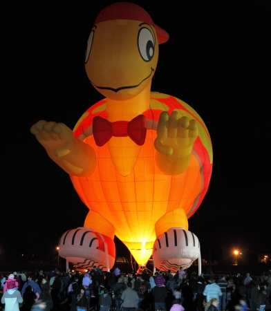 happening: A huge balloon in the form of Teenage Mutant Ninja Turtles  Happening glowing balloons in the night sky Editorial