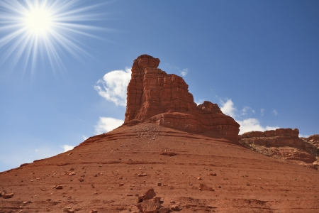 grandiose: Monument Valley in the United States   A grandiose rock from red sandstone and the bright midday sun Stock Photo