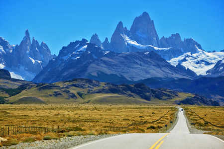 Famous rock Fitz Roy peaks in the Andes  Magnificent panorama of snow-capped mountains in Patagonia  To mountains leads the asphalt road
