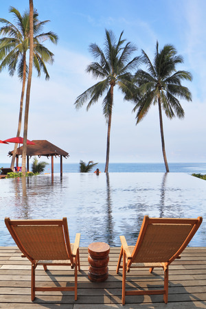 loungers:  Great review for a luxury beachfront pool, the ocean and swaying palm trees.  Charming lookout for two. Two convenient comfortable guest sun loungers and a bedside table are worth on a wooden platform.
