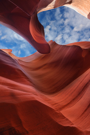 Stone waves and cloudy sky. The Magic Antelope Canyon in the Navajo Reservation, the United States. photo