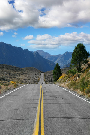The road went off. Great American road goes through the scenic desert and mountain