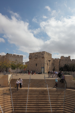 The famous Jaffa Gate in Jerusalem. Tourists on the marble steps in front of Old City