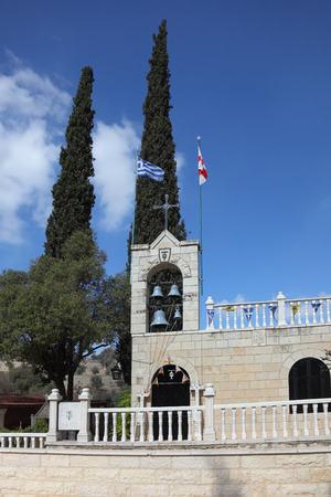 The bell tower, topped by a cross, a Christian church in Jerusalem.  photo