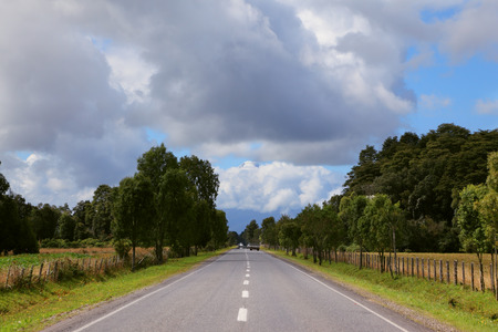fenced in:  Scenic highway in South America - Carretera Austral. Farmland fenced low fence