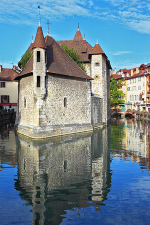 ancient prison: Clear early morning. The bastion turned into prison, is reflected in channel water. The charming ancient city of Annecy in Provence