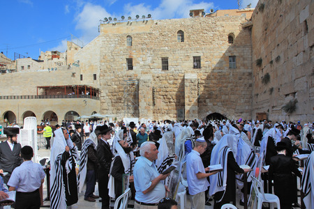 sukkoth festival: JERUSALEM, ISRAEL - SEPTEMBER 20, 2013:The Western Wall of the Temple in Jerusalem. Morning Sukkot. Many religious Jews in traditional robes tallit gathered for prayer.