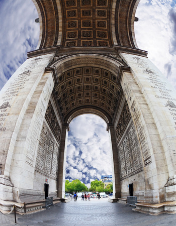 winning location: The striking and unexpected angle Arc de Triomphe in Paris. Background - the cloudy sky. Photo was taken Fisheye lens