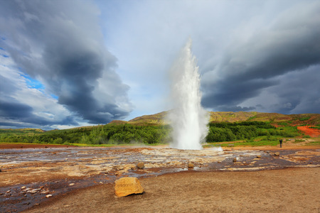 wintery day: Famous geyser Strokkur in Iceland. Geyser erupts every few minutes Stock Photo