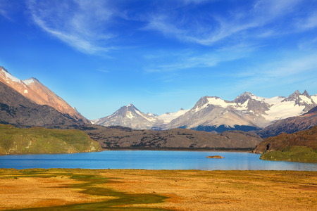 moreno: A  blue lake in a picturesque valley surrounded by snow-capped mountains. National Park Perito Moreno  in Patagonia, Argentina Stock Photo