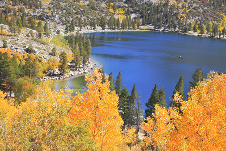 unforgettable: Magic beauty the dark blue lake in Yosemitis National park. Gold crowns create an unforgettable picture.