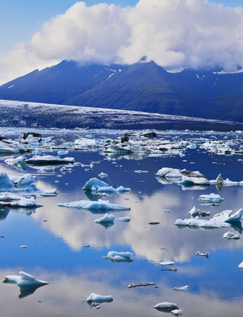 jokulsarlon: South-east Iceland in July. Transparent icebergs and ice floes in the Ice Lagoon Jokulsarlon Stock Photo