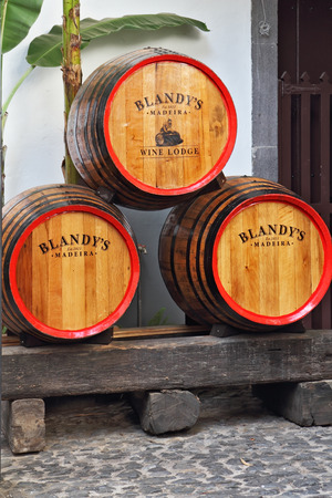 MADEIRA  ISLAND, PORTUGAL - OCTOBER 8: Classic huge oak barrels of wine  Madera. Storage of wine well-known firm