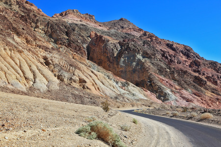 vanish: A great American road. The road to dry and wild-colored mountains of Death Valley
