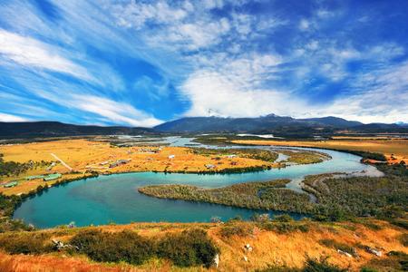 meandering: Glen Serrano. Meandering river bed of yellow autumn coast